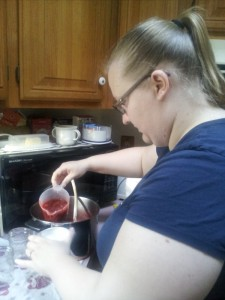 Here I am pouring the hot mixture into jars