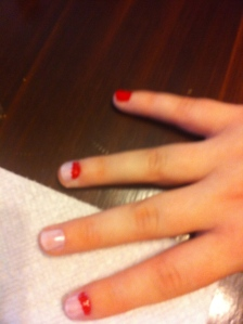I painted my pinky finger solid red and the tops of my other nails red as well.